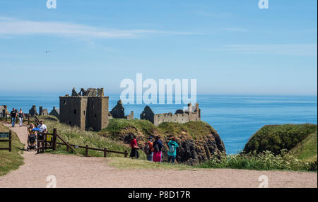 Dunottar Castle, Stonehaven, Aberdeenshire - one of Scotland's most identifiable strongholds, built in the 15th and 1y6th centuries. Visitors approach - Stock Photo