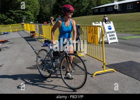 Melissa Anne Landau competiting in the bike segment in the 2018 Stissing Triathlon - Stock Photo