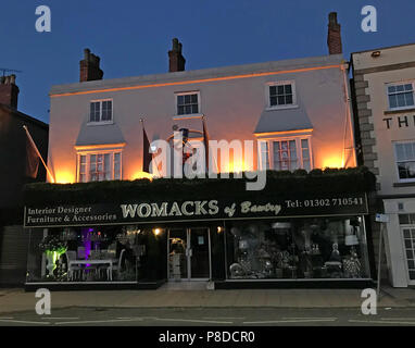 Womacks of Bawtry at dusk, 16-18 High St, Bawtry, Doncaster, South Yorkshire, England, UK,  DN10 6JE - Stock Photo