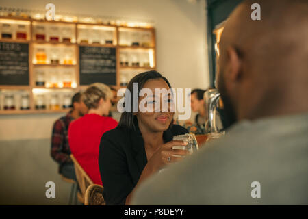 Smiling young woman enjoying a night out with her boyfriend - Stock Photo