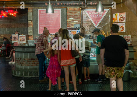 Visitors to Chelsea Market in New York stay indoors and beat the heat wave at the L'Arte del Gelato kiosk on Tuesday, July 3, 2018. The National Weather Service has issued a hot weather advisory until Wednesday evening citing the oppressive heat and humidity. (© Richard  B. Levine) - Stock Photo