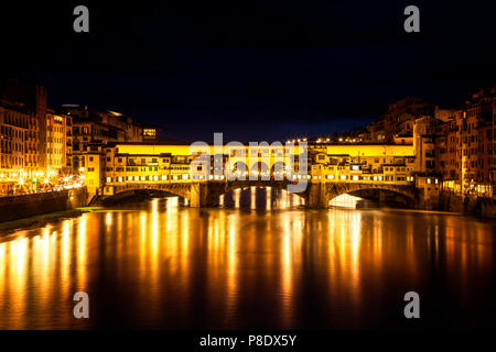 Florence, Italy's iconic Ponte Vecchio at night - Stock Photo