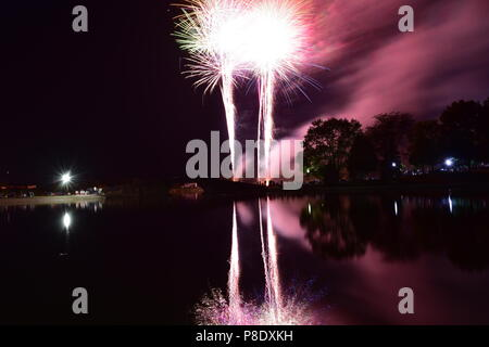 Bloomington, Illinois, USA - 4th July 2018 - July 4th Fireworks in Miller Park Lake - Stock Photo