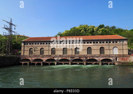 The old and historic hydroelectric power plant ' Angelo Bertini', of 1906, on the river Adda - Stock Photo