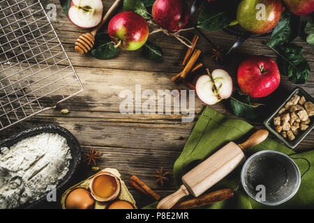 Autumn cooking background, Apple pie baking concept, fresh red apples, sweet spices, sugar, flour, rolling pin, eggs, baking utensils, wooden backgrou - Stock Photo