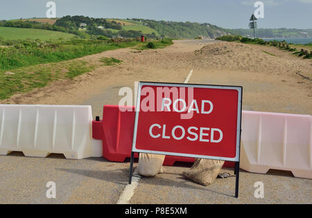 Road closed. The A379 at Slapton Sands, after a large section of road had been destroyed during Storm Emma in March 2018. - Stock Photo