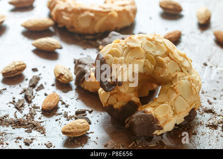Homemade shortbread cookies with almonds and chocolate. Crispy dessert for tea and coffee. Selective focus - Stock Photo