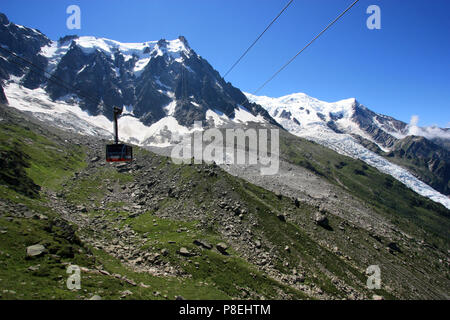 Cable car heading for the peak of the Aiguille-du-Midi in the Mont Blanc massif in France - Stock Photo
