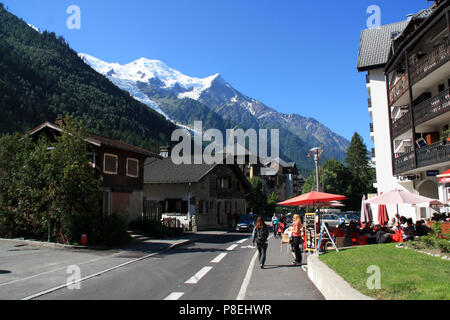 The Mont Blanc rising majestically above the lovely village of Chamonix, Haute Savoie, France - Stock Photo
