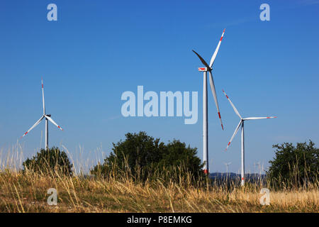 Wind generators, Windmills in the landscape, Windgeneratoren in der Landschaft, Bayern, Deutschland - Stock Photo