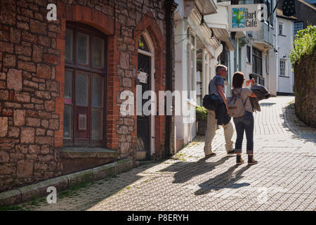 23 May 2018: Dartmouth, Devon, UK - Couple taking photos on a cell phone in Church Close. - Stock Photo