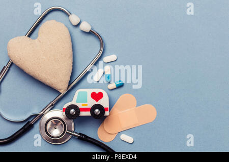 Medical background. healthy heart concept with stephoscope ambulance and heart shape - Stock Photo