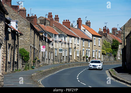 Car in Thornton-le-Dale, North Yorkshire, England UK - Stock Photo