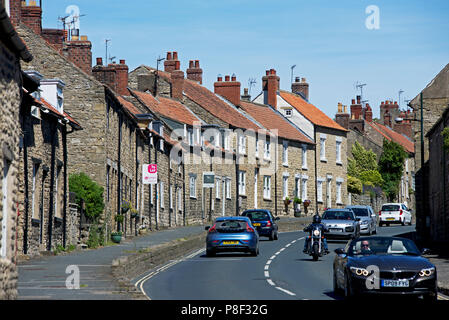 Traffic in Thornton-le-Dale, North Yorkshire, England UK - Stock Photo