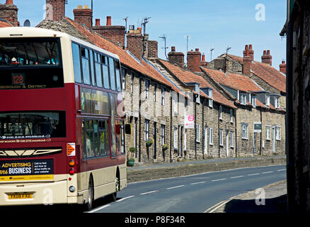 Bus in Thornton-le-Dale, North Yorkshire, England UK - Stock Photo