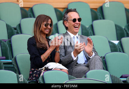 Richard E. Grant and Binti Velani in the royal box on centre court on day nine of the Wimbledon Championships at the All England Lawn Tennis and Croquet Club, Wimbledon. - Stock Photo