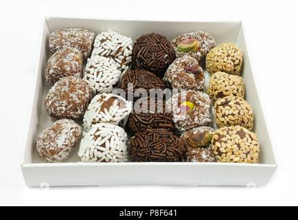 Sweet Food, Assorted Round Chocolate Candy Balls or Chocolate Bonbons in Paper Box Isolated on White Background. - Stock Photo