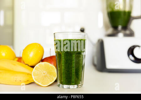 Fresh green smoothie from fruit and vegetables for a healthy lifestyle. Spinach, apple, banana, lemon. - Stock Photo