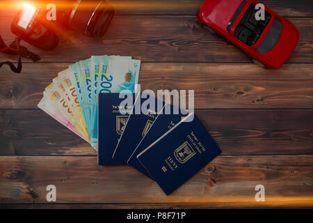 Stack of israeli money bills of 200 shekel and israeli passport - Stock Photo