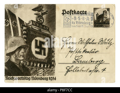German historical postal card: The 6th party Congress of the NSDAP in Nuremberg in 1934, SS standard bearer in a steel helmet. Germany, Third Reich - Stock Photo