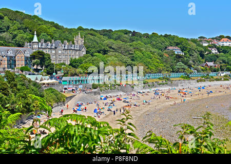 People enjoying the summer sunshine on the beach at Langland Bay, Gower,South Wales - Stock Photo