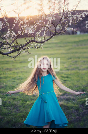 Girl standing in a field spinning around, Bulgaria