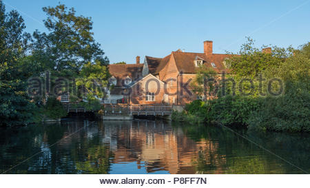 Flatford Mill, once owned by the father of John Constable, is a Grade I listed watermill on the River Stour at Flatford near East Bergholt in Suffolk. - Stock Photo