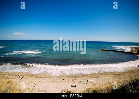 beach on the Mediterranean in a clear sunny day, Greece, Halkidiki. - Stock Photo