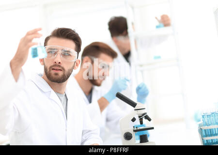closeup.scientists in the laboratory - Stock Photo