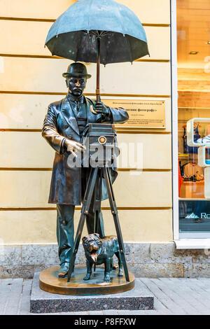 ST.PETERSBURG, RUSSIA - JUNE 15, 2016: Bronze monument to photographer in St. Petersburg - Stock Photo