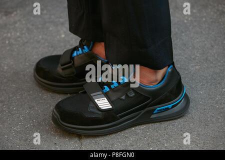 087610968901 ... MILAN - JUNE 17  Man with black and blue Prada shoes before Prada  fashion show