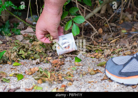 Picking up lost money - Stock Photo