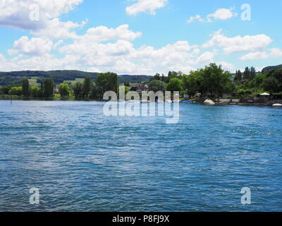 Beauty landscapes of european STEIN am RHEIN town in SWITZERLAND and alpine Rhine River in swiss canton of Schaffhausen with medieval buildings, cloud - Stock Photo