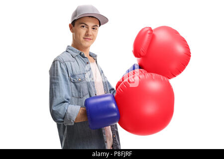 Teenage boy with a pair of big boxing gloves isolated on white background - Stock Photo
