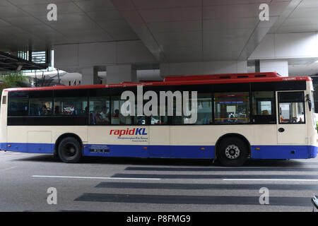 A Rapid KL bus goes past Nu Sentral Shopping Centre, Kuala Lumpur, Malaysia. - Stock Photo