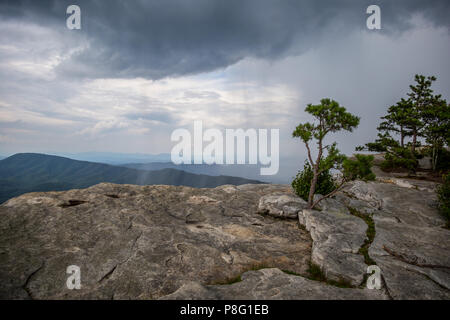 Stormy Sky and Rain on top of McAfee Knob on Appalachian Trail Rocky Foreground - Stock Photo