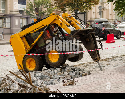 Yellow construction machinery for repair and construction - Stock Photo