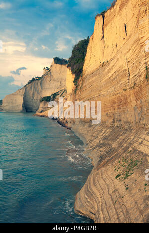 Sedimentary Rock Cliff at the sea, Limestone Natural Structure Coast, Mointain Chain of Layered Stone Formation along the Beach High Shoreline Eroded  - Stock Photo