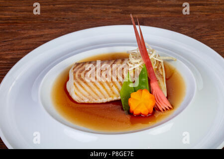 Baked cod fish in miso sause - Stock Photo