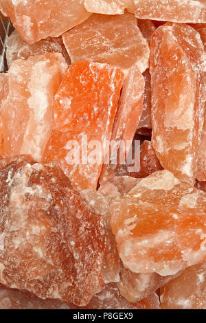 Pink salt minerals in rock from Himalaya - Stock Photo