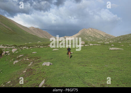 Kyrgyz horserider, Jyrgalan Valley, Kyrgyzstan - Stock Photo