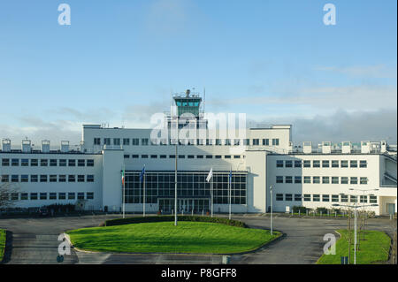 Dublin, Ireland - 23 December, 2017. Control tower in Dublin airport near terminal. - Stock Photo