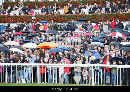 Hoppegarten, Germany, crowd in rainy weather - Stock Photo