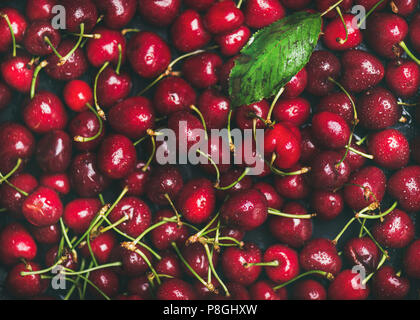 Fresh sweet cherry texture, wallpaper and background. Flat-lay of wet sweet cherries, top view. Summer food or local market produce concept - Stock Photo