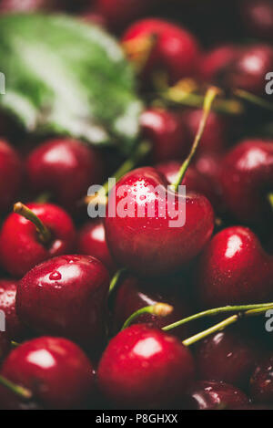 Fresh sweet cherry texture, wallpaper and background. Wet sweet cherries, selective focus, close-up. Summer food or local market produce concept - Stock Photo