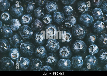 Fresh blueberry texture, wallpaper and background. Flat-lay of wet dark forest blueberries, top view. Summer food or local market produce concept - Stock Photo