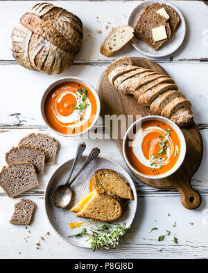 Tomato Soup, Bread, and Grilled Cheese Sandwich - Stock Photo