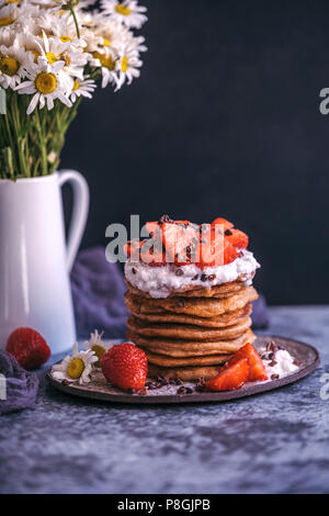 Stack of pancakes with strawberries and cream - Stock Photo