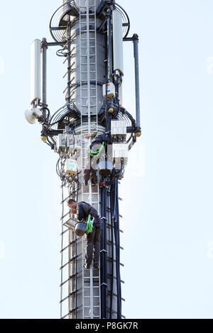 Pfingstberg, Germany, technicians work on a radio mast - Stock Photo