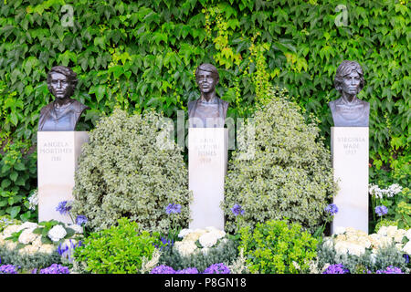 Sculpture busts of British Ladies Champions Angela Mortimer, Ann Jones, Virginia Wade, grounds at Wimbledon All England Lawn Tennis Club, UK - Stock Photo